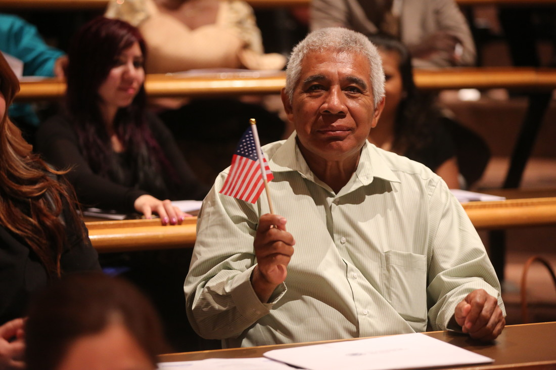 A new U.S. citizen holding an American flag