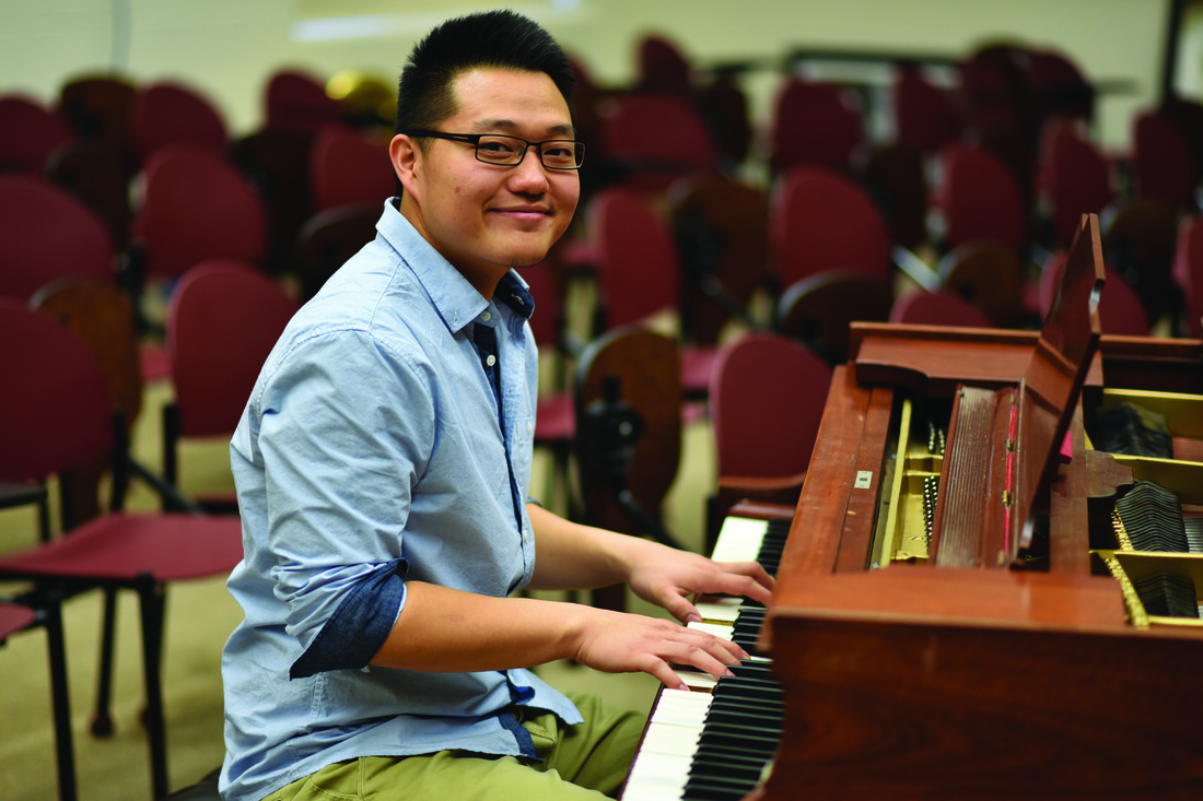 U of M Crookston's Henry Soung sitting at the piano