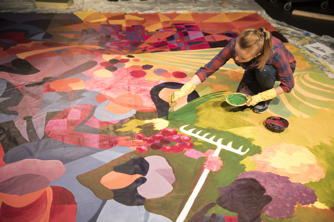 Laura Johnson working on her mural