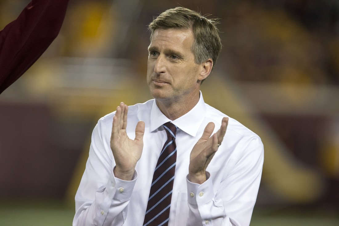 University of Minnesota Athletic Director Mark Coyle clapping