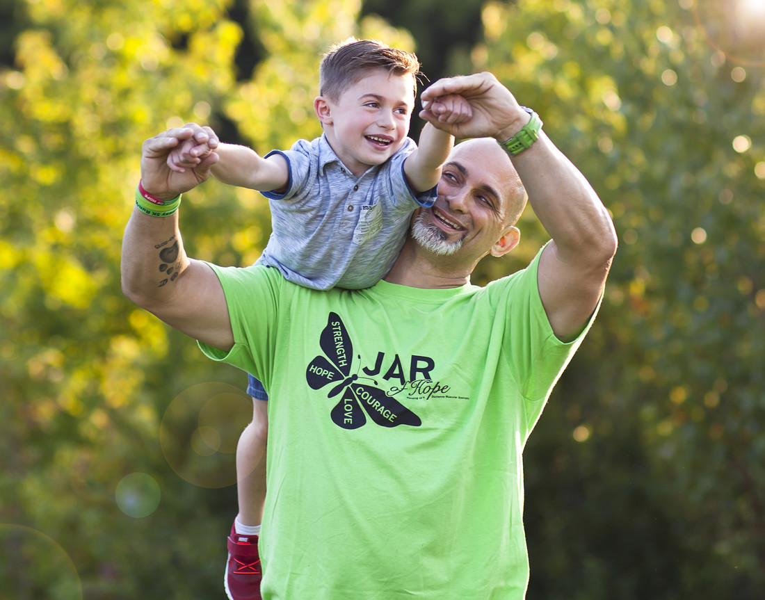 James Raffone holding his son Jamsey on his shoulder