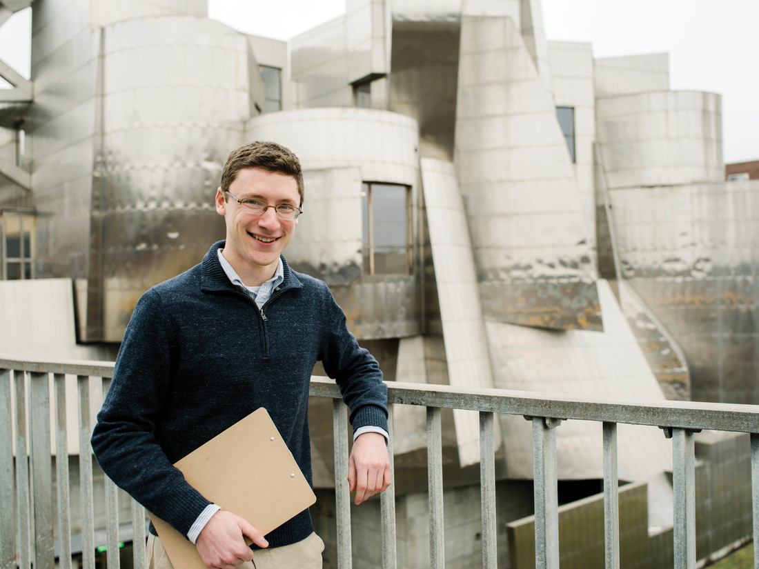 Ben Weil standing in front of the Weisman Art Museum