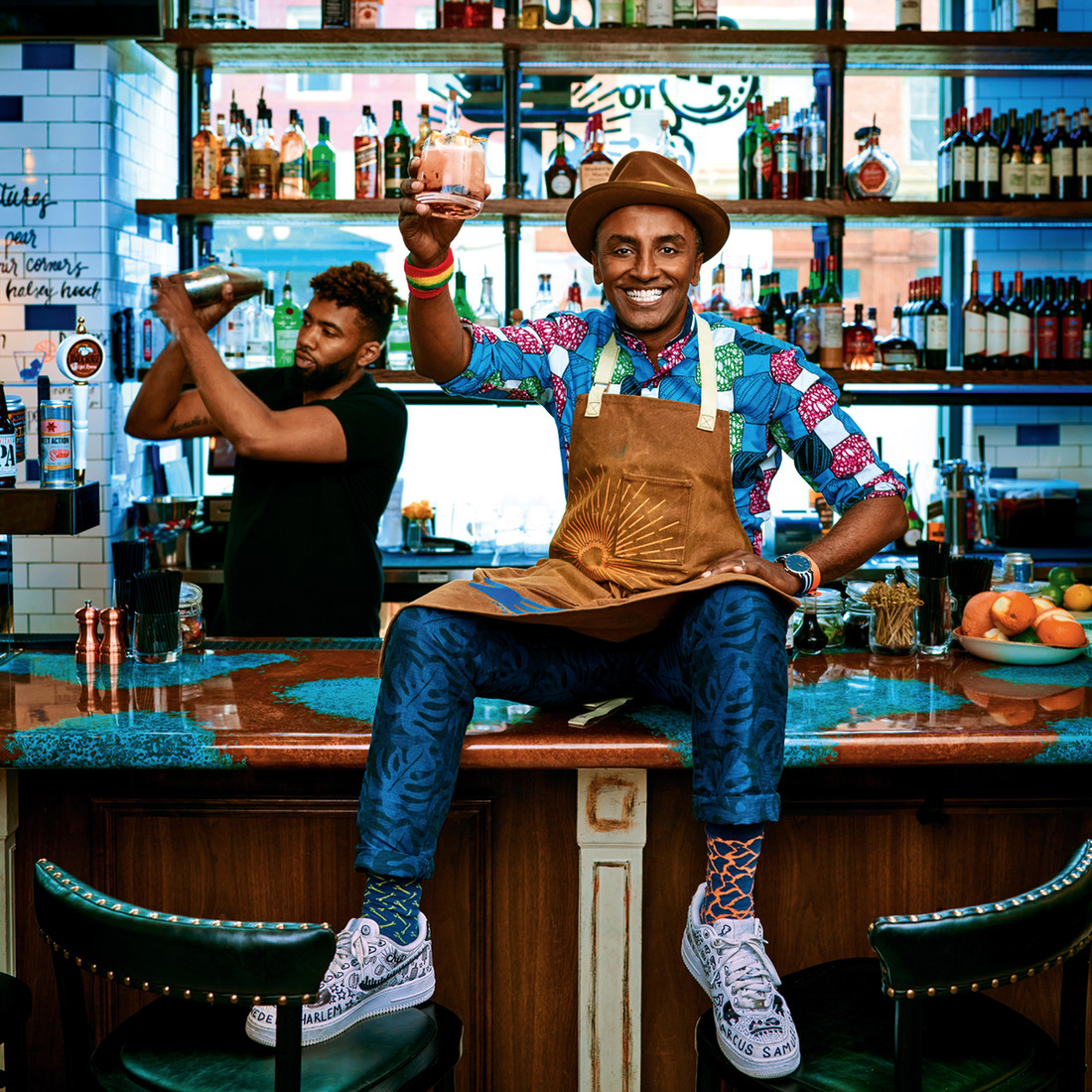 Marcus Samuelsson on the bar in one of his restaurants