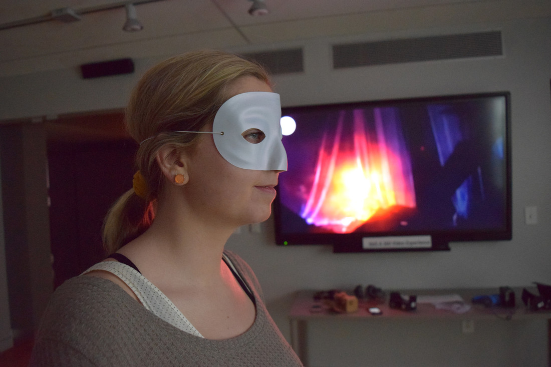 Woman looking at a screen with a mask
