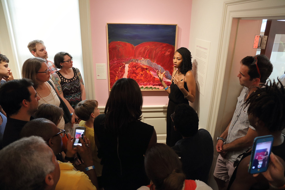 Imani Williford gives a gallery talk during the opening night of Songs of a Secret Country.