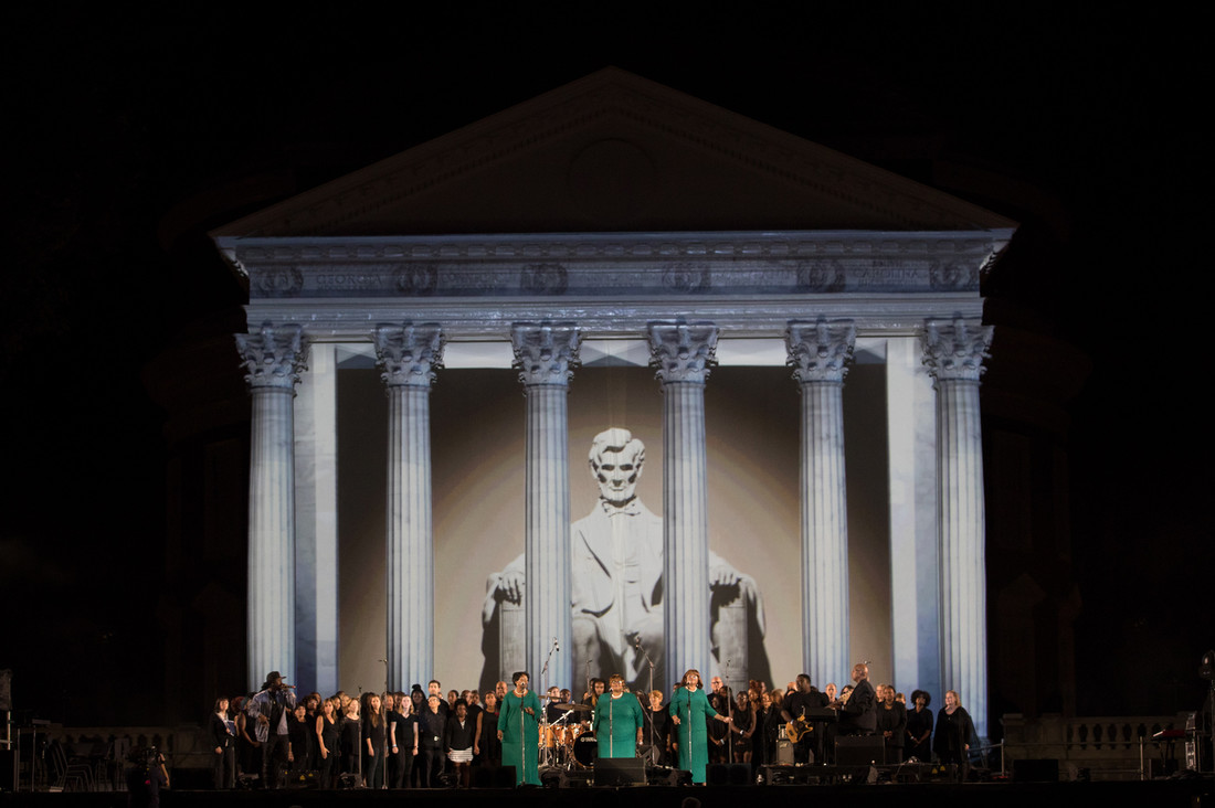 The Ingramettes in front of the a projection mapped to show the Lincoln Memorial.
