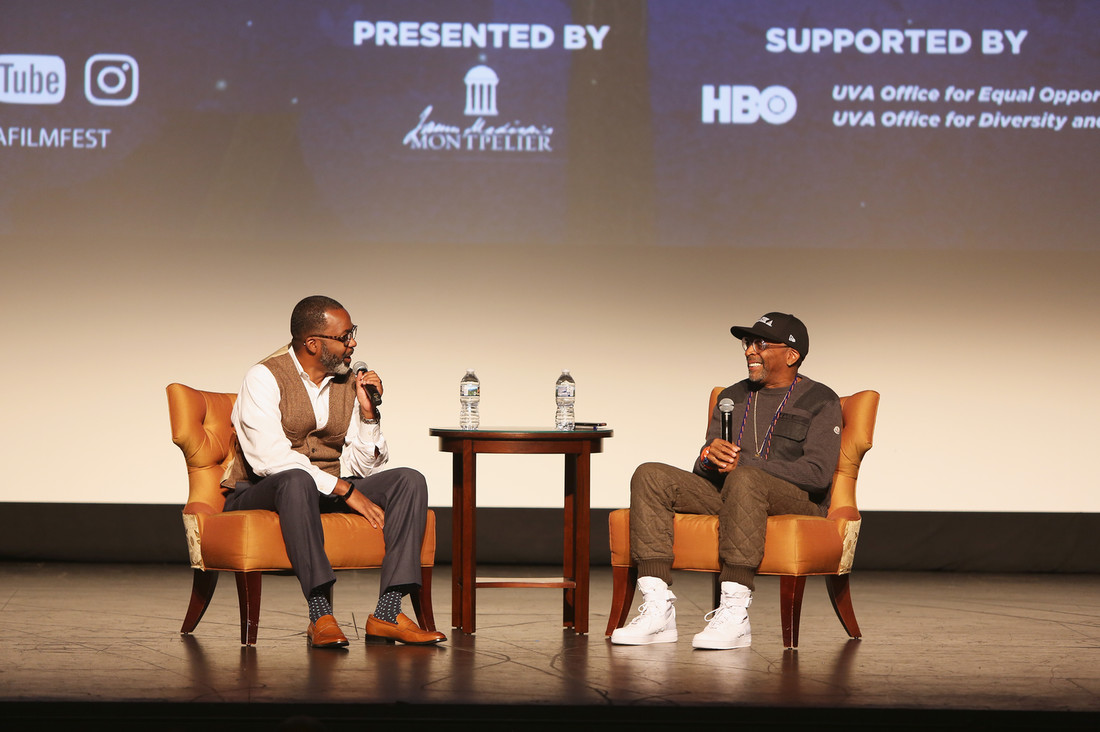 Moderator Maurice Wallace and director Spike Lee speak onstage at the 4 Little Girls screening and Q&A at Paramount Theater during the 30th Annual Virginia Film Festival